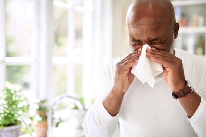 Man Sneezing Due To Pollen